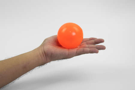 hand man holding color ball isolated on white background