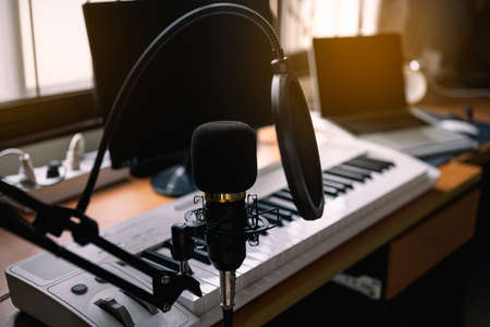 Close up of microphone and piano at the sound recording room