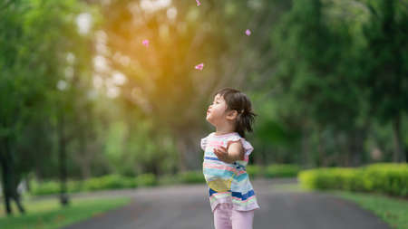 Cute baby playing and jomping at the garden, cute baby outdoor activity concept Stock Photo