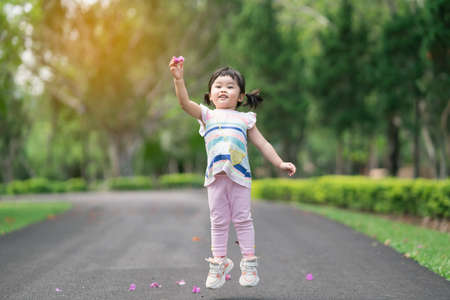 Cute baby sitting at the garden, cute baby outdoor activity concept Stock Photo