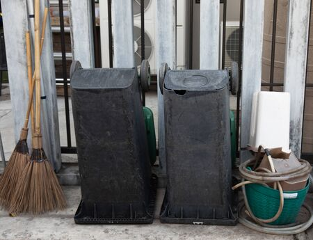 Trash brooms and other cleaning equipment were cleaned and sorted in order after using. Stockfoto