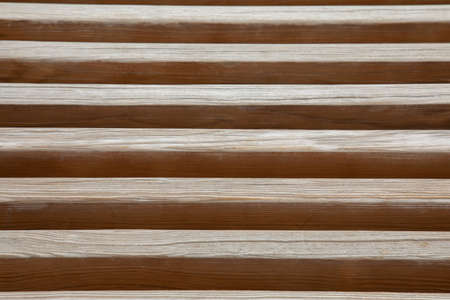 Close up and perspective view of wooden batten in vertical layer shows beautiful pattern and texture of wood material. It is attractive for using as background, backdrop and abstract art. Stockfoto