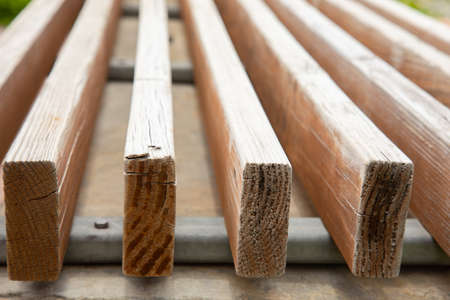Close up and perspective view of wooden batten which is in the front cross-section shows beautiful pattern and texture of wood material. It is attractive for using as background with copy space.