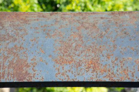 Top view and close shot of rusted metal beam installed at high level shows the beautiful texture and colorful surface. The steel structure has been abandoned outdoor which is deteriorated and aged. Stockfoto