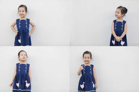 Sets or groups of photo of cute asian girl with a bright blue dress, contrasting with the skin color and beautiful smile on white background and copy space that everyone will fall in love.