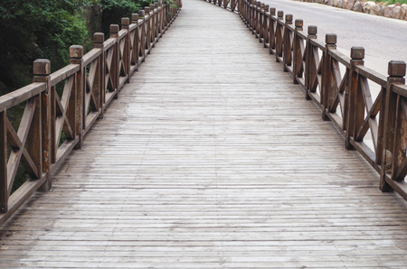 with no one: Road guardrail, wooden bridge, no one