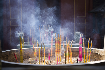 Burning incense in temples and praying for blessing