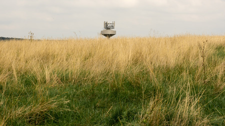 Top of the water tank with radio transmitters in the grass field