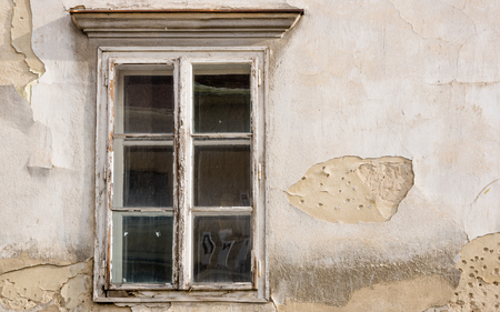 Windows 3.0 / Tiled wooden window on an old building Stock Photo