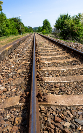 Long rail tracks – portrait Stock Photo