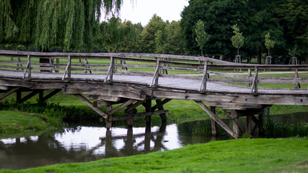 Wooden bridge leading to the park side view Stock Photo