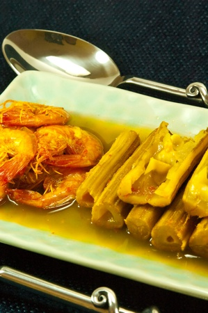 Hot and sour curry form drumstick tree and prawn  photo