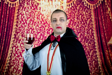 Portrait of a man with Count Dracula style make-up  Shot in a studio  Stock Photo - 15812498