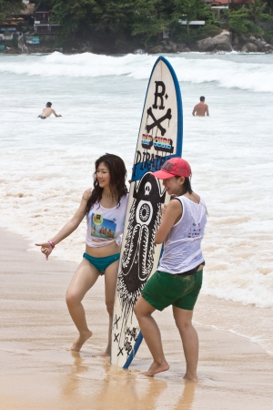 kelly: Kata beach, Phuket Thailand - September 6: Unidentified participants of the rip curl  girls go surfing day 2013, September 6,2013 in Kata beach, Phuket Thailand Editorial
