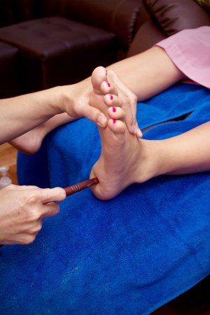 spa foot treatment by wood stick Stock Photo - 23302384