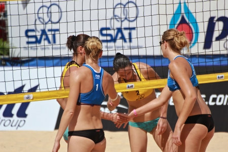 PHUKET, THAILAND - OCTOBER 29: unidentified sweden and ukraine players in  the qualifying rounds of the FIVB Beach Volleyball, Phuket Thailand Open  powered by PTT on October 29, 2013 at Karon Beach in Phuket, Thailand