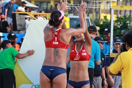 PHUKET, THAILAND - NOVEMBER 3:China's Chen Xue and Xinyi Xia made  beating USAs Emily Day and Summer Ross 2-0 on November 3, 2011 at Karon Beach in Phuket, Thailand