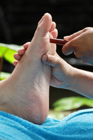 foot massage by wood stick for eyes Stock Photo - 23576021