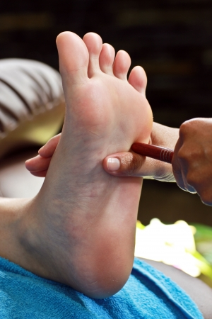 restore energy flow: foot massage by wood stick for intestine