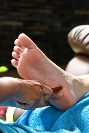 foot massage by wood stick for urinary bladder photo