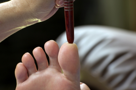 frontal sinuses: foot massage by wood stick for frontal sinuses