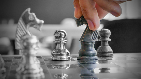 chess player: Hand of chess player moving the checkmate