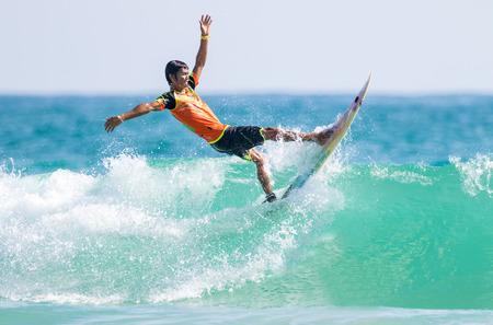 short wave: PHUKET - JUN 06: unidentified surfer in action catching  waves in rainy season at Kata beach Phuket on jun 06, 2016  in Kata beach, Phuket, Thailand.
