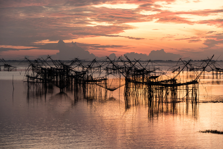 Asia Fishermen in the early morning golden light at Klong Pak Para, a wetland, Phatthalung, Thailand. Stock Photo