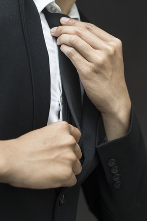 young business man adjusting his neck tie