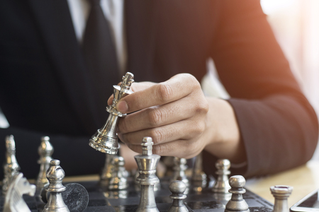 move in: concept businessman thinking about her next move in a game of chess Stock Photo