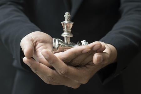 business man leader of a successful business holding the chess in hand Banque d'images