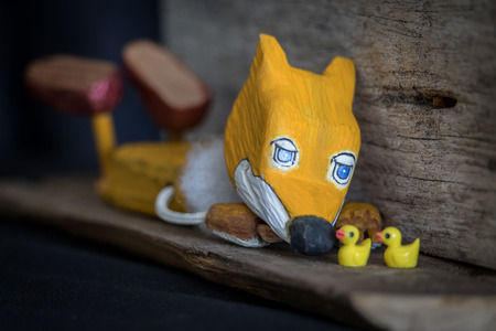 wooden toy of yellow jackal story