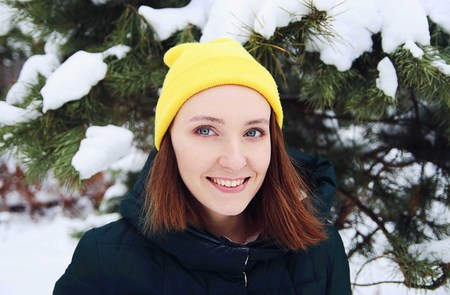 Portrait of young beautiful redhead woman in winter forest 写真素材