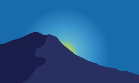 captivating: Silhouette of mountain with moon at night