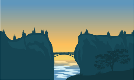 silhouette of bridge and cliff at afternoon