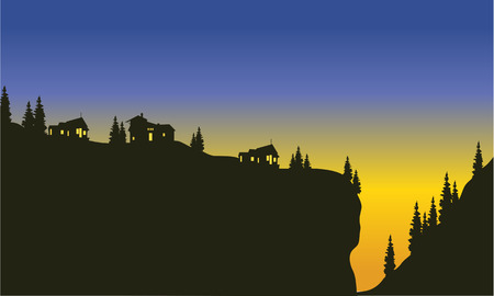 Silhouette of trees on the cliff at the afternoon