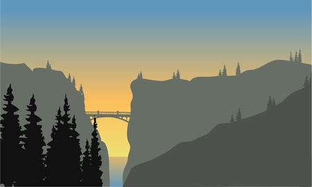 Landscape of cliff and fir tress at sunset