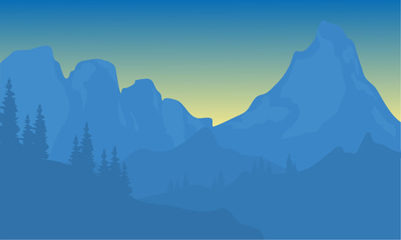 Silhouette of mountain with blue background at sunrise