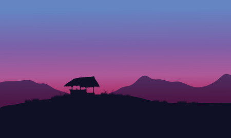 Silhouette of hut with purple backgrounds in the hills
