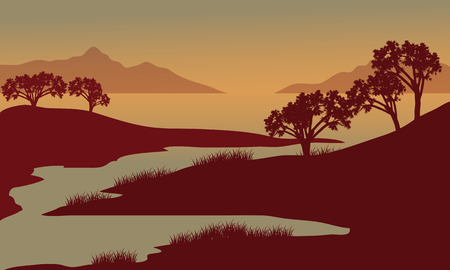 Silhouette of river at the morning with grass and trees