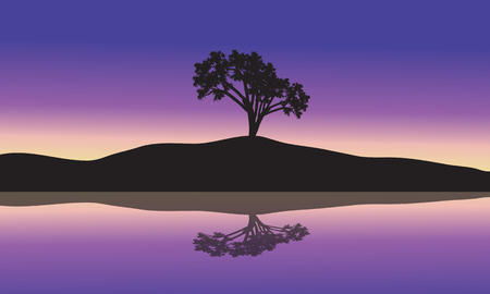 dusky: landscape with silhouette of a single tree in a hill at sunset