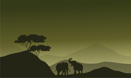serengeti: Silhouette of elephant in hills with green backgrounds