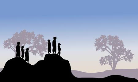 Silhouette of meerkat family in hills