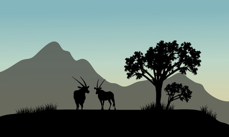 Silhouette of antelope in hills with mountain backgrounds Иллюстрация