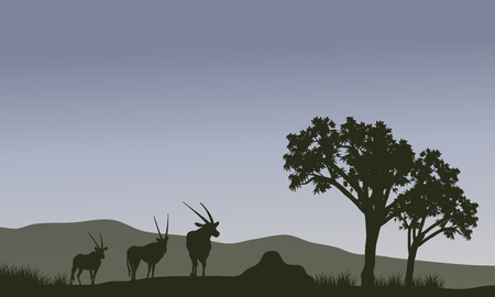 Antelope family and tree silhouette in hills Иллюстрация