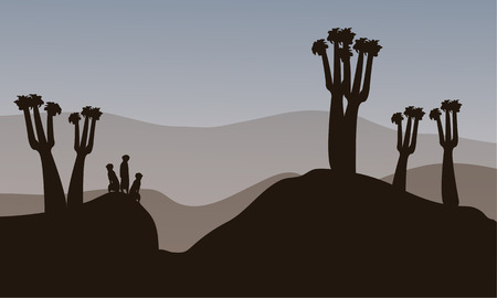 watchful: Meerkat silhouette in the hills with gray backgrounds