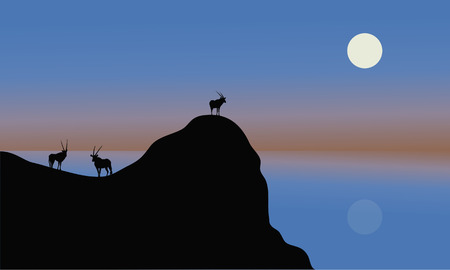 plant stand: Silhouette of antelope in cliff with blue backgrounds