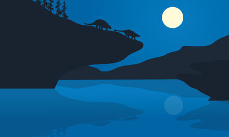 behemoth: Silhouette of ankylosaurus at the night in cliff
