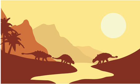Silhouette of ankylosaurus at the morning with yellow backgrounds
