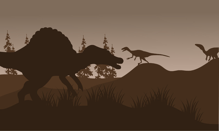 silhouete: Silhouete of spinosaurus and eoraptor in hills with brown backgrounds